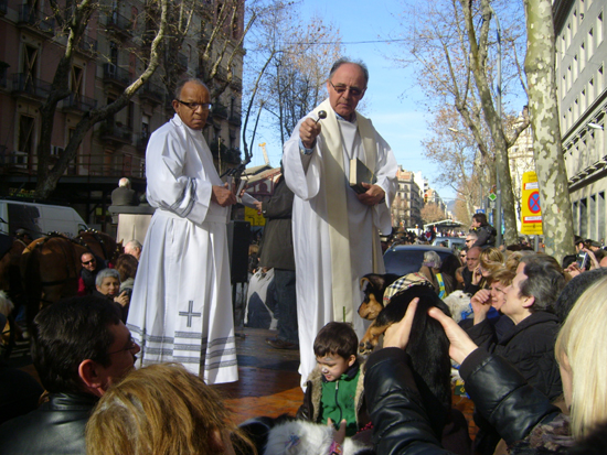 Priests blessing pets at Els Tres Tombs.