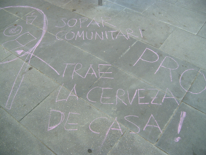 message written in chalk on a Poble Sec square