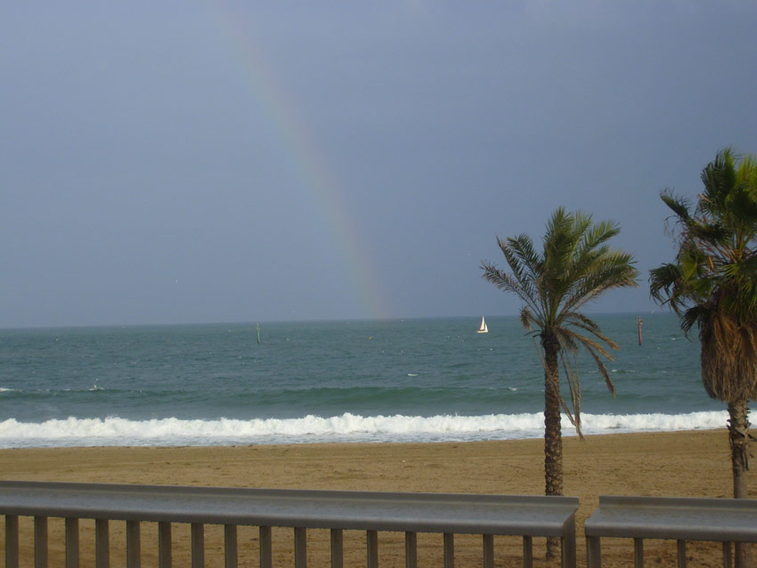 Rainbow over Barcelona beach